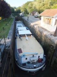 The grain barge FILLS the lock