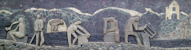 Bas relief made of, and explaining the production of, slate