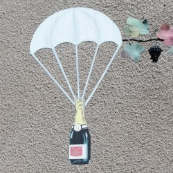 A metal sculpture on the side of a house - in case of emergency, airdrop a bottle of Champagne
