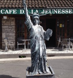 Cafe of Youth in Revin, with pint-sized statue of liberty