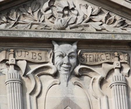 A bust of the Devil on the side of the Stenay Hotel de Ville