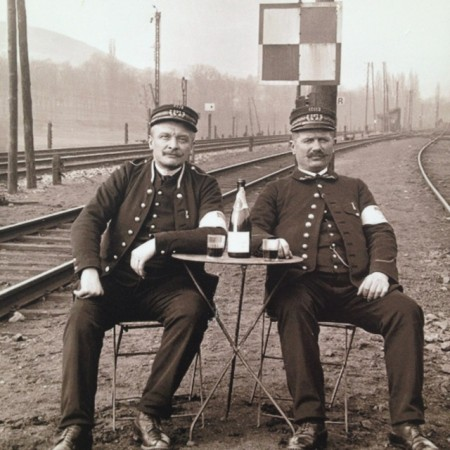 Train workers on lunch break with a bottle of wine