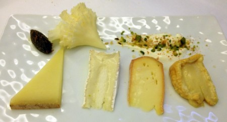 The final cheese plate at Les Gourmets, including Comté, Camembert, Epoisses, and Tete-de-Moine