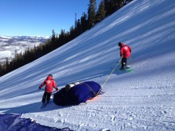 Ski patrol hauling ~300 pounds of 'A' net on the men's downhill course