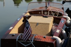 Classic wooden boat, complete with US nautical flag