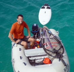 The dinghy loaded with windsurfing gear