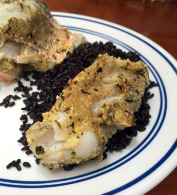 Herb-crusted Lionfish on black rice
