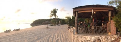 "Private beach party at ""a private island in the Exumas"""