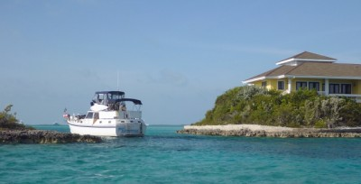 """Miss A"" transits the narrow cut between Big Major and Fowl Cay"