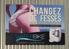 "Billboard for excercise equipment; ""Change Buttocks"""
