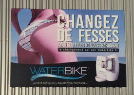 "Billboard for excercise equipment; ""Change Buttocks"""