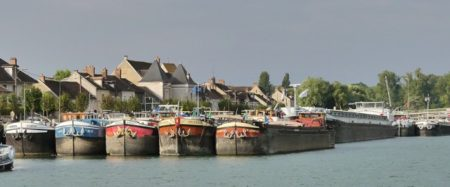 Commercial barges docked in St. Mammes